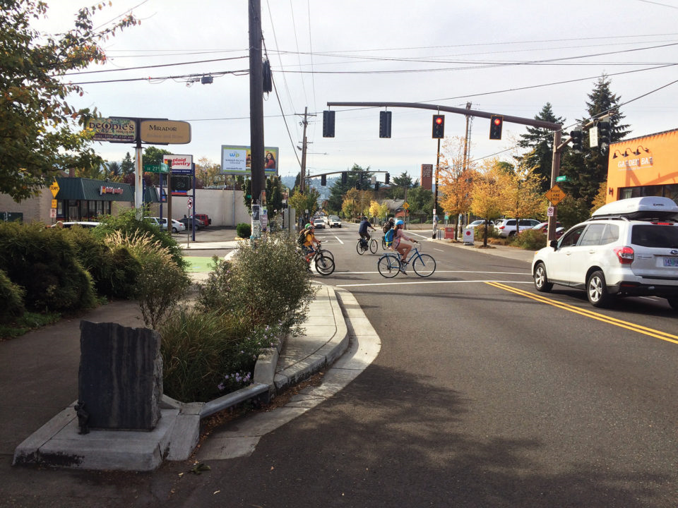 Image of people on bikes riding across Division St